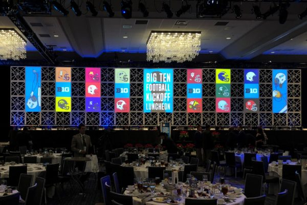 Quest-Events-Corporate-Special-Event-Big-10-Luncheon-Hotel-Convention-Center-Staging-Scenic-Design-Drape-GeoPanels-Lectern-Chandelier