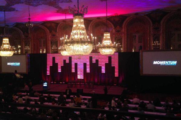 Quest-Events-Corporate-Special-Event-Momentum-Conference-Stage-Scenic-Design-Moddim-Drape-Uplight