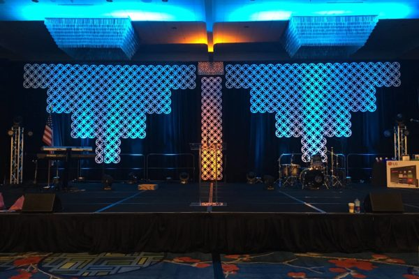Quest-Events-Scenic-Design-Corporate-Event-Geo-Panels-Chandelier-Drape-Uplight