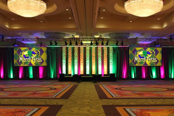 Quest-Events-Special-Event-Stage-Scenic-Design-Mardi-Gras-Theme-Party-Hotel-Convention-Conference-Center-Moddim-Drape-Uplight