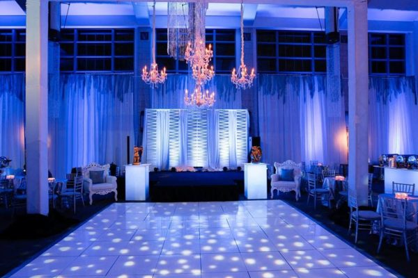 Quest-Events-Special-Event-Stage-Scenic-Design-Reception-Chandeliers-Moddim-Drape-Uplight