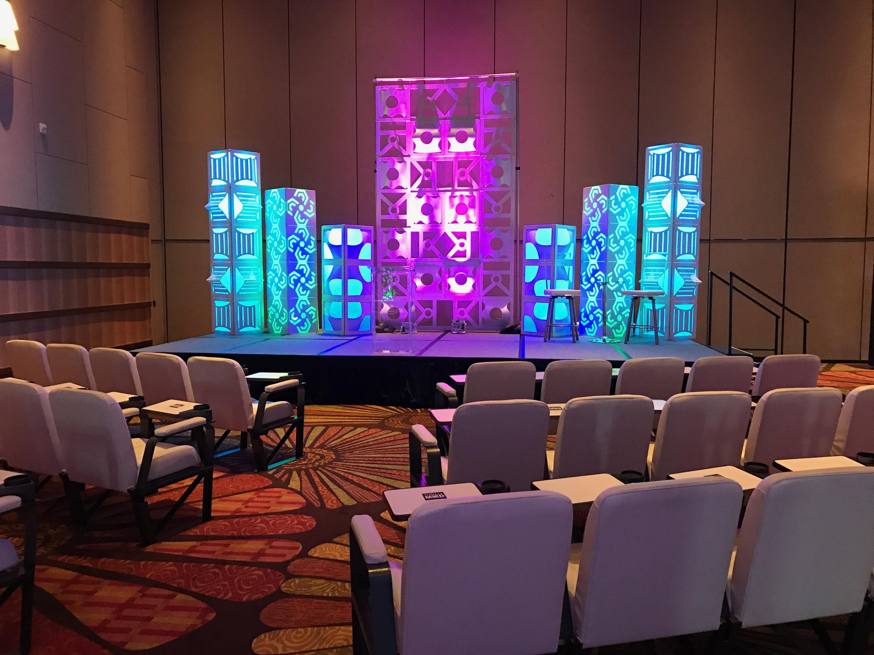 Conference rental session seating and stage backdrops