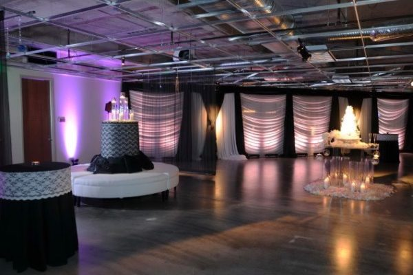 Quest-Events-Visual-Elements-Nashville-Special-Events-Furnishings-White-Leather-Round-Seating-Unit-Specialty-Drape-Uplight-Lucite-Pedestals-min