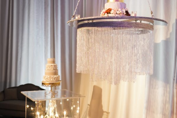 Quest-Events-Visual-Elements-Nashville-Tennessee-Special-Events-Wedding-Reception-Seating-Beaded-Chandeliers-Drape-Acrylic-Pedestal-Side-Table-min