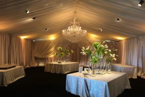 Custom-champagne-satin-perimeter-ivory-sheer-layering-drapery-event-rental-Wedding-Alabama-tent
