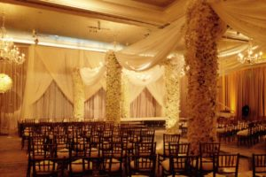 Wedding-ceremony-drapery-champagne-satin-ivory-sheer-beaded-drapery-scallops-truss-event-drapery-rental