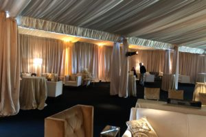 wedding-drapery-tent-custom-champagne-satin-ceiling-treatment-satin-perimeter-ivory-sheer-layering-event-drapery-rentals