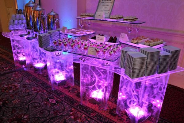 Swirled-Acrylic-Buffet-Table-Serpentine-Uplighting-Purple-Quest-Event-Rental-Totally-Mod