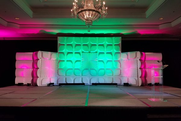 quest-events-psav-cvent-formset-stage-backdrop-fans-petals-silos-rental-scenic
