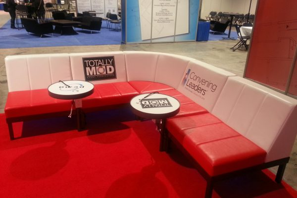 totally-mod-L-couch-event-rental-branded-seating-furnishing-quest-events-swing-tables