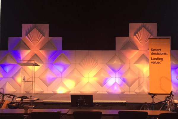 FormSet-Stage-Conference-Backdrop-Design-Patterns-Quest-Event-Rentals-Meeting-Fans-In-Form-Uplighting