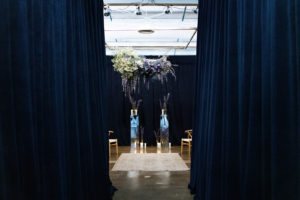 Austin-Quest-Event-Rentals-Navy-Velour-Drape-Rental-Wedding-Ceremony-Backdrop-Perimeter-Sponsorshi