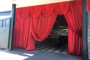 red-flourish-tc-book-release-red-satin-swags-entryway-drape-atlanta-quest-events-rental